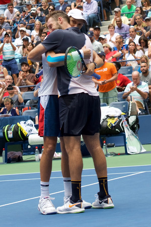 NEW YORK - SEPTEMBER 7, 2018: 2018 US Open men doubles champions Mike Bryan (L) and Jack Sock of United States celebrate victory after final match at the Billie Jean King National Tennis Center Redactioneel