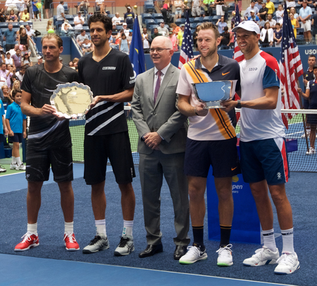 NEW YORK - SEPTEMBER 7, 2018: Lukasz Kubot of Poland (L), Marcelo Melo of Brazil with 2018 US Open men doubles champions Jack Sock and Mike Bryan of United States during trophy presentation