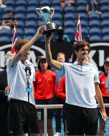 MELBOURNE, AUSTRALIA - JANUARY 27, 2019: Grand Slam Mens Doubles champions Nicolas Mahut (L) and Pierre-Hugues Herbert of France during trophy presentation after 2019 Australian Open final match Editöryel