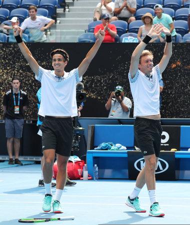 MELBOURNE, AUSTRALIA - JANUARY 27, 2019: Grand Slam Mens Doubles champions Pierre-Hugues Herbert (L) and Nicolas Mahut of France celebrates victory after 2019 Australian Open final in Melbourne Park