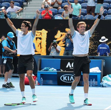MELBOURNE, AUSTRALIA - JANUARY 27, 2019: Grand Slam Men's Doubles champions Pierre-Hugues Herbert (L) and Nicolas Mahut of France celebrates victory after 2019 Australian Open final in Melbourne Park