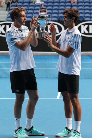MELBOURNE, AUSTRALIA - JANUARY 27, 2019: Grand Slam Mens Doubles champions Nicolas Mahut (L) and Pierre-Hugues Herbert of France during trophy presentation after 2019 Australian Open final match Redactioneel