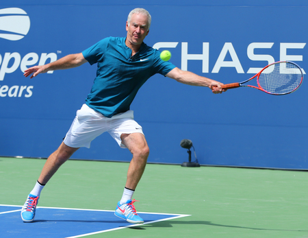 NEW YORK - AUGUST 22, 2018: Seven times Grand Slam Champion John McEnroe in action during 2018 US Open exhibition match at newly open Louis Armstrong Stadium at Billie Jean King National Tennis Center 新聞圖片