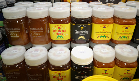 MELBOURNE, AUSTRALIA - JANUARY 24, 2019: Artisan Australian Honey at Queen Victoria Market in Melbourne, Australia. It is a major landmark and the largest open air market in the Southern Hemisphere Editorial