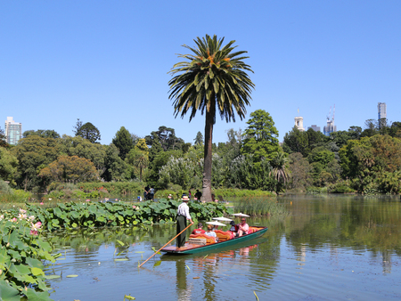 MELBOURNE, AUSTRALIA - JANUARY 28, 2019: Guided Punting Boat Tour on the Ornamental lake in the Royal Botanic Gardens. The Royal Botanic Gardens were founded in 1846