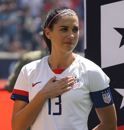 HARRISON, NJ - MAY 26, 2019: U.S. Womens National Soccer Team captain Alex Morgan #13 during National Anthem before friendly game against Mexico as preparation for 2019 Womens World Cup in Harrison
