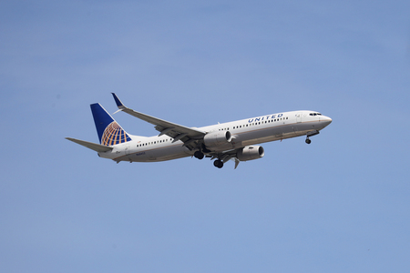 NEWARK, NEW JERSEY - MAY 26, 2019: United Airlines Boeing 737 descending for landing at Newark Liberty International Airport in New Jersey