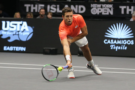 UNIONDALE, NEW YORK - FEBRUARY 17, 2019: 2019 New York Open doubles champion Andreas Mies of Germany in action during final match in Uniondale, New York Stok Fotoğraf - 124911590