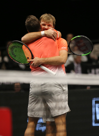 UNIONDALE, NEW YORK - FEBRUARY 17, 2019: 2019 New York Open doubles champions Kevin Krawietz and Andreas Mies of Germany celebrate victory after final match in Uniondale, New York