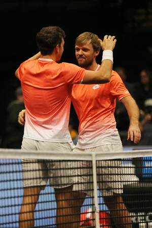 UNIONDALE, NEW YORK - FEBRUARY 17, 2019: 2019 New York Open doubles champions Kevin Krawietz and Andreas Mies of Germany celebrate victory after final match in Uniondale, New York Stok Fotoğraf - 124911593
