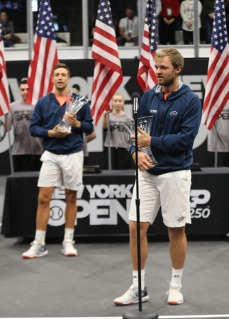 UNIONDALE, NEW YORK - FEBRUARY 17, 2019: 2019 New York Open doubles champion Kevin Krawietz of Germany during trophy presentation after final match in Uniondale, New York Stok Fotoğraf - 124911594