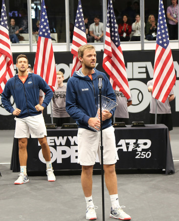 UNIONDALE, NEW YORK - FEBRUARY 17, 2019: 2019 New York Open doubles champion Kevin Krawietz of Germany during trophy presentation after final match in Uniondale, New York