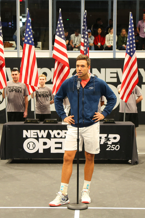 UNIONDALE, NEW YORK - FEBRUARY 17, 2019: 2019 New York Open doubles champion Andreas Mies of Germany during trophy presentation after final match in Uniondale, New York