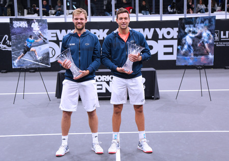UNIONDALE, NEW YORK - FEBRUARY 17, 2019: 2019 New York Open doubles champions Kevin Krawietz (L) and Andreas Mies of Germany during trophy presentation after final match in Uniondale, New York Stok Fotoğraf - 124911599