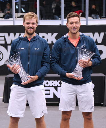 UNIONDALE, NEW YORK - FEBRUARY 17, 2019: 2019 New York Open doubles champions Kevin Krawietz (L) and Andreas Mies of Germany during trophy presentation after final match in Uniondale, New York Stok Fotoğraf - 124911600