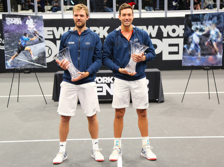UNIONDALE, NEW YORK - FEBRUARY 17, 2019: 2019 New York Open doubles champions Kevin Krawietz (L) and Andreas Mies of Germany during trophy presentation after final match in Uniondale, New York Stok Fotoğraf - 124911601