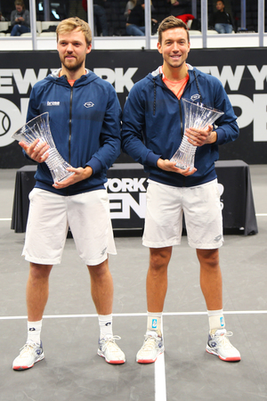 UNIONDALE, NEW YORK - FEBRUARY 17, 2019: 2019 New York Open doubles champions Kevin Krawietz (L) and Andreas Mies of Germany during trophy presentation after final match in Uniondale, New York Stok Fotoğraf - 124911602