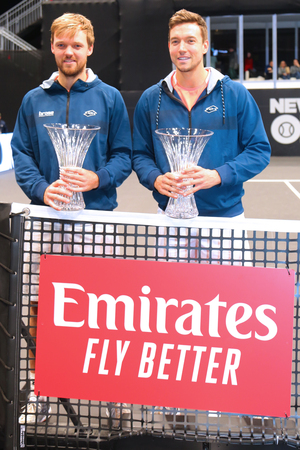 UNIONDALE, NEW YORK - FEBRUARY 17, 2019: 2019 New York Open doubles champions Kevin Krawietz (L) and Andreas Mies of Germany during trophy presentation after final match in Uniondale, New York