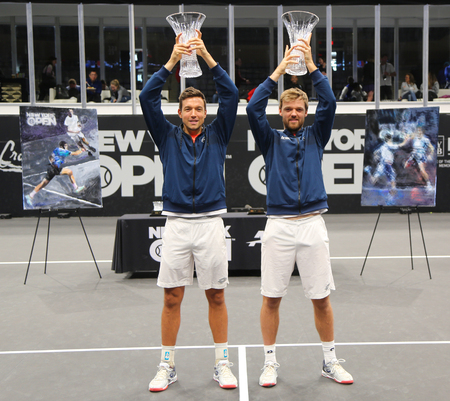 UNIONDALE, NEW YORK - FEBRUARY 17, 2019: 2019 New York Open doubles champions Kevin Krawietz (R) and Andreas Mies of Germany during trophy presentation after final match in Uniondale, New York Stok Fotoğraf - 124911604