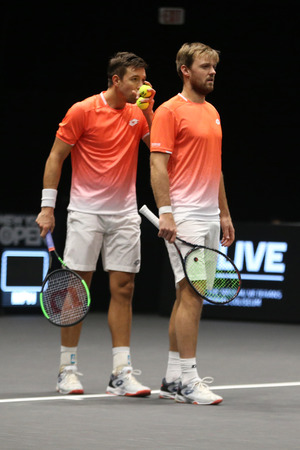 UNIONDALE, NEW YORK - FEBRUARY 17, 2019: 2019 New York Open doubles champions Kevin Krawietz and Andreas Mies of Germany in action during final match in Uniondale, New York
