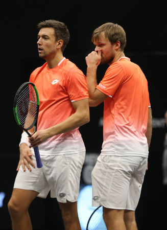 UNIONDALE, NEW YORK - FEBRUARY 17, 2019: 2019 New York Open doubles champions Kevin Krawietz and Andreas Mies of Germany in action during final match in Uniondale, New York Stok Fotoğraf - 124911607
