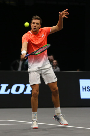 UNIONDALE, NEW YORK - FEBRUARY 17, 2019: 2019 New York Open doubles champion Andreas Mies of Germany in action during final match in Uniondale, New York Stok Fotoğraf - 124911609