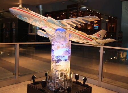NEW YORK - MAY 29, 2016: : From New York... to the World 3D printed hand painted sculpture by Charles Fazzino at  American Airlines Terminal 8 at JFK airport.