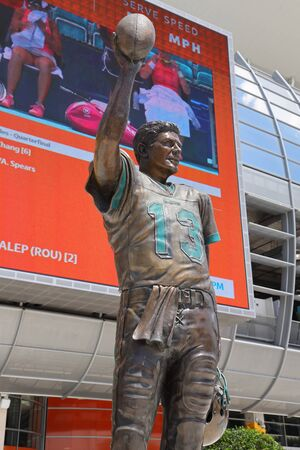 MIAMI GARDENS, FLORIDA - MARCH 27, 2019: Statue of Hall of Fame Dolphins quarterback Dan Marino in front of Hard Rock Stadium in Miami Gardens, Florida Sajtókép