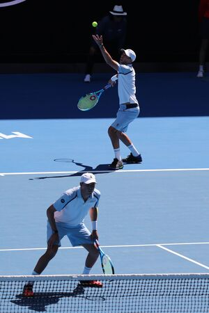 MELBOURNE, AUSTRALIA - JANUARY 23, 2019: Grand Slam champions Mike and Bob Bryan of United States in action during quarterfinal match at 2019 Australian Open in Melbourne Park Stok Fotoğraf - 126923472
