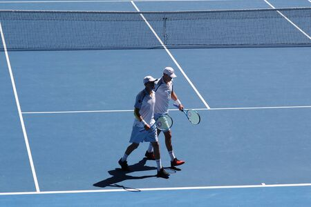 MELBOURNE, AUSTRALIA - JANUARY 23, 2019: Grand Slam champions Mike and Bob Bryan of United States in action during quarterfinal match at 2019 Australian Open in Melbourne Park