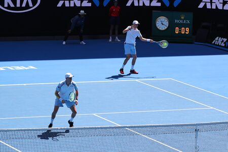 MELBOURNE, AUSTRALIA - JANUARY 23, 2019: Grand Slam champions Mike and Bob Bryan of United States in action during quarterfinal match at 2019 Australian Open in Melbourne Park Stok Fotoğraf - 127624040