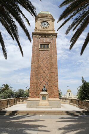 ST KILDA, AUSTRALIA - JANUARY 25, 2019: Clock tower and bronze bust commemorate Carlo Catani in the suburb of St. Kilda in Melbourne.