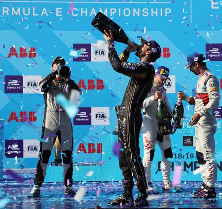 NEW YORK - JULY 14, 2019: Jean-Eric Vergne (FRA) of DS Techeetah Team celebrates with champagne his historic two-time FIA Formula E World Championship title during 2019 New York City E-Prix in Brooklyn 新聞圖片