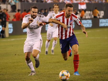 EAST RUTHERFORD, NJ - JULY 26, 2019: Dani Carvajal of Real Madrid #2 (L) and Saul Niguez of Atletico de Madrid in action during match in the 2019 International Champions Cup at MetLife stadium.
