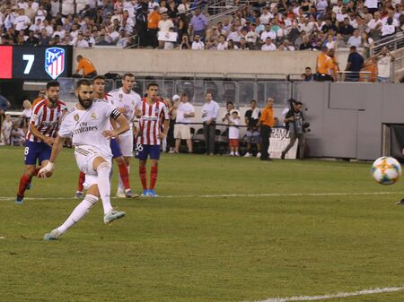 EAST RUTHERFORD, NJ - JULY 26, 2019: Karim Benzema of Real Madrid #9 kicks penalty shot during match against Atletico de Madrid in the 2019 International Champions Cup at MetLife stadium. Real Madrid lost 3-7