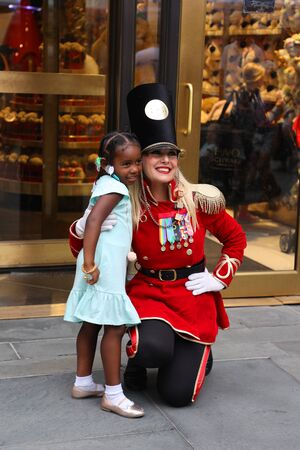 NEW YORK - JULY 18, 2019: A doorman dressed as a toy soldier stands outside newly reopened the FAO Schwarz flagship store at Rockefeller Plaza in Midtown Manhattan