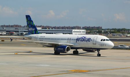 NEW YORK- AUGUST 3, 2019: JetBlue plane on tarmac at John F Kennedy International Airport in New York