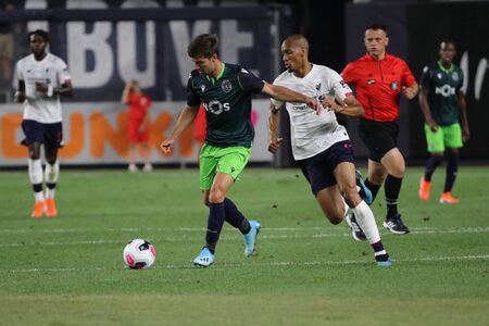 NEW YORK - JULY 24, 2019: Midfielder Fabinho of Liverpool FC (3) in action against Sporting CP in the 2019 Western Union Cup game at Yankees stadium in New York 報道画像