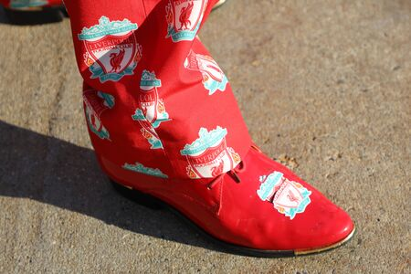 NEW YORK - JULY 24, 2019: Liverpool fan wears shoes with team logo before the 2019 Western Union Cup game Liverpool FC against Sporting CP at Yankee stadium in New York