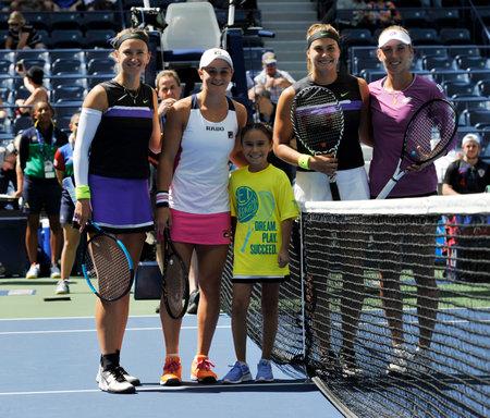 NEW YORK - SEPTEMBER 8, 2019: Victoria Azarenka BLR, Ashleigh Barty AUS, Elise Mertens BEL and Aryna Sabalenka BLR before  2019 US Open womens doubles championship match at National Tennis Center Editöryel