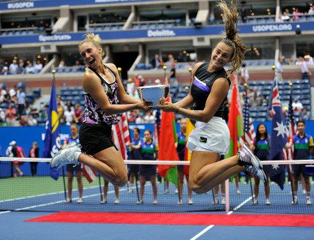 NEW YORK - SEPTEMBER 8, 2019: 2019 US Open womens doubles champions Elise Mertens of Belgium (L) and Aryna Sabalenka of Belarus during trophy presentation after final match at National Tennis Center Editöryel