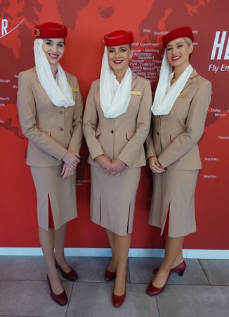 NEW YORK - AUGUST 31, 2019: Emirates Airlines flight attendants at the Emirates Airlines booth during 2019 US Open at the Billie Jean King National Tennis Center in New York
