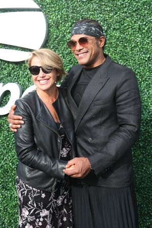 NEW YORK - AUGUST 26, 2019: American journalist and author Katie Couric and American singer and songwriter Maxwell attend 2019 US Open opening night ceremony at National Tennis Center in New York