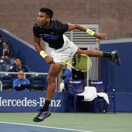 NEW YORK - AUGUST 27, 2019: Professional tennis player Felix Auger Aliassime Canada in action during his 2019 US Open first round match at Billie Jean King National Tennis Center in New York