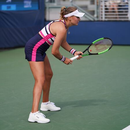 NEW YORK - AUGUST 27, 2019: Professional tennis player Kateryna Kozlova of Ukraine in action during her 2019 US Open first round match at Billie Jean King National Tennis Center in New York