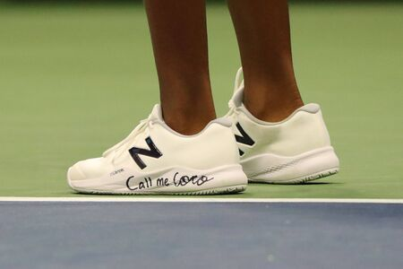 NEW YORK - AUGUST 31, 2019: Professional tennis player Coco Gauff of United States wears custom New Balance tennis shoes with sign Call me Coco during her 2019 US Open third round match