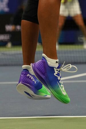 NEW YORK - SEPTEMBER 2, 2019: Grand Slam Champion Naomi Osaka of Japan wears custom Nike Air Zoom Zero tennis shoes with sign on Japanese during her 2019 US Open round of 16 match