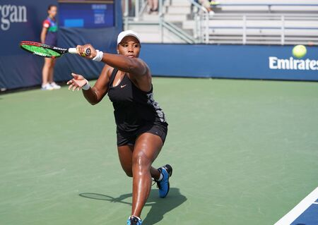 NEW YORK - AUGUST 27, 2019: Professional tennis player Taylor Townsend of United States in action during her 2019 US Open first round match at Billie Jean King National Tennis Center