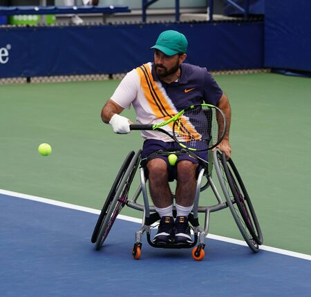 NEW YORK - SEPTEMBER 8, 2018: Wheelchair tennis player David Wagner of USA in action during his Wheelchair Quad Singles semifinal match at 2018 US Open at Billie Jean King National Tennis Center Redactioneel