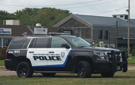 SOUTHAMPTON, NEW YORK - SEPTEMBER 30, 2019: Southampton Police Department car in Southampton Village, Long Island. Southampton is an upscale village in The Hamptons on Long Island